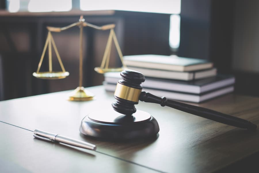 scales of justice and gavel on table